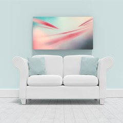 Composite image of empty couch against blank picture frame