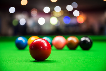 Red snooker ball on snooker table