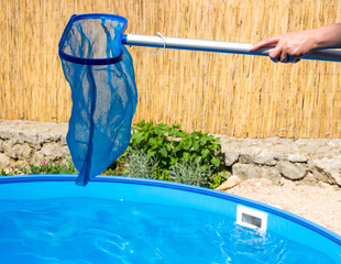 Woman hands cleaning pool