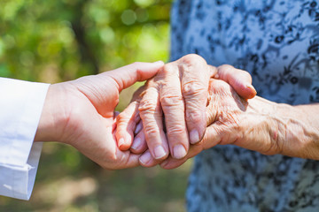 Trembling elderly hands