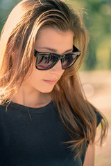Cute girl in sunglasses with her hair loose.