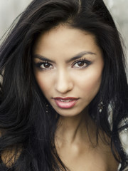Beautiful exotic womans face and dark hair