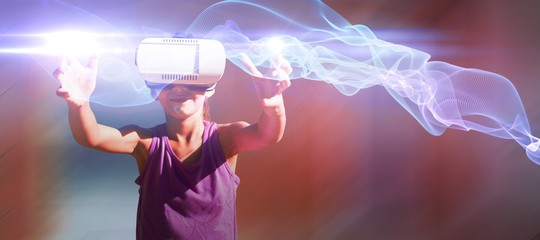 Composite image of young girl carrying a virtual reality glasses
