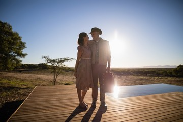 Couple standing together on wooden plank