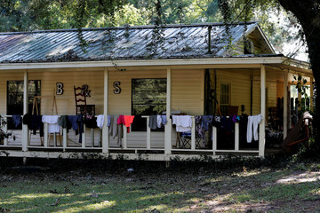 Laundry is left to dry on the porch of a flood damaged house in the aftermath of Tropical Storm Harvey in Vidor