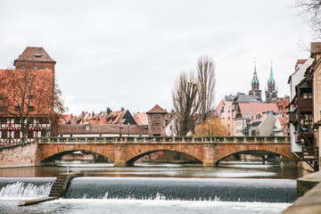 View of the pedestrian bridge and various buildings and houses in winter in Nuremberg in Germany. City view.