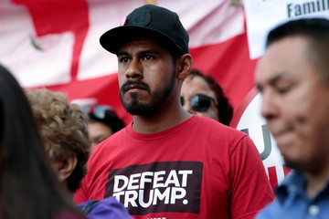 Deferred Action for Childhood Arrivals program recipient Christian Torres, stands with supporters of the program during a rally outside the Edward R. Roybal Federal Building in Los Angeles, California