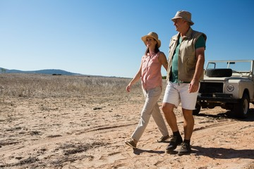Couple walking on landscape