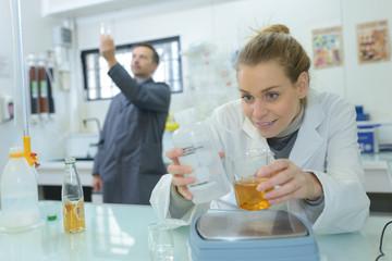 laboratory assistant analyzing a liquid