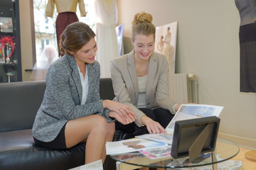 two female business colleagues chatting new product line