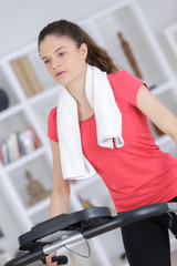 woman running on a treadmill in her living room
