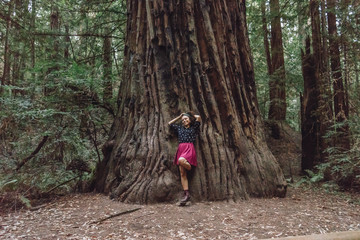 Girl leaning on a giant tree