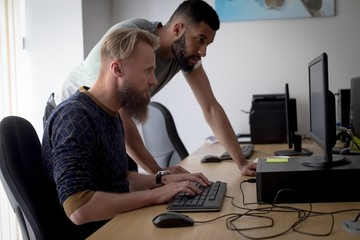 Colleagues working together at desk
