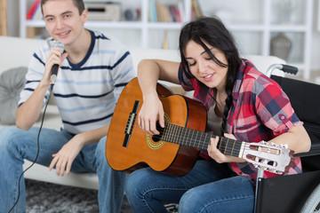 friends singing by guitar indoor