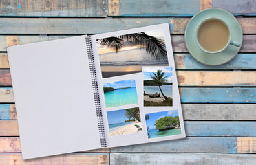 Photobook Album with Travel Photo on Wooden Floor Table with Coffee or Tea in Cup