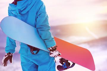 Closeup woman back snowboarder snowboard snowboarding