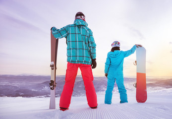 Skier snowboarder family skiing snowboarding concept
