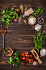 herbs and spices on wooden background. Food background. Cooking concept.