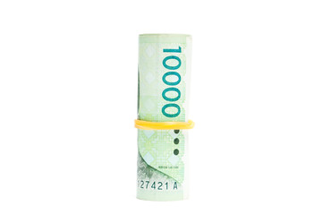 South Korean won currency tied rubber band on white background