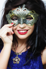 lifestyle and people concept: beautiful brunette woman with mask