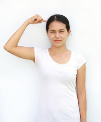 Young asian woman in T-Shirt Showing expression point her head or hair.
