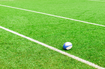rugby ball on the ground