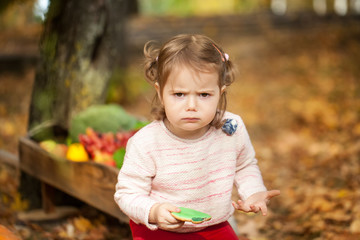 Angry girl in the autumn park