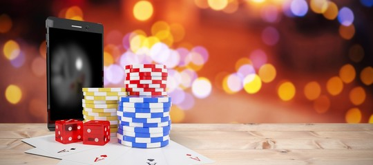 Composite image of mobile phone with stack of gambling chips and