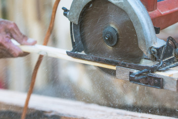 Male carpenter working on wooden plank