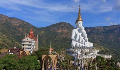 White buddha statue in Thai temple.