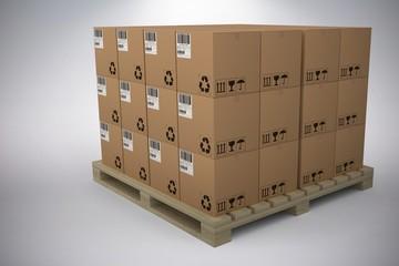 Composite image of cardboard boxes arranged on wooden pallet