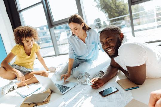 Positive international students studing on the floor