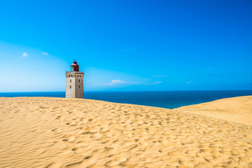 Abandoned Rubjerg Knude Lighthouse and sand dunes, North Sea coast, Denmark