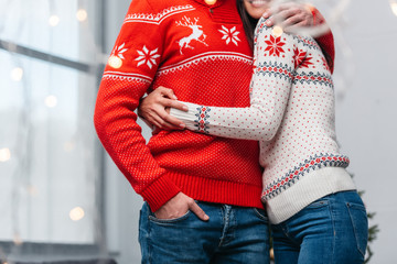 couple in knitted sweaters