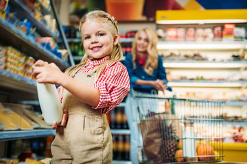girl holding bottle of milk