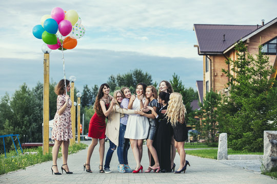Young beautiful happy women celebrate bachelorette party at the pier