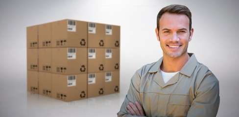 Composite image of confident delivery man standing with arms