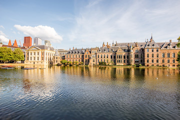 Cityscape view on the small lake with beautiful old buildings and modern skyscrapers on the background in the centre of Haag city, Netherland