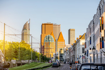 Fototapete - Street view on the modern office district with skyscrapers during the sunset in Haag city, Netherlands
