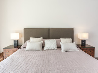 A cozy bed for two in the bedroom. luminaries are illuminated.