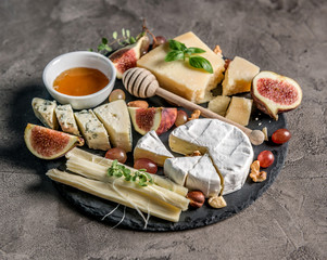 Cheese plate served with wine, nuts and honey