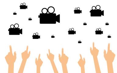 Hände zeigen auf alte Videokameras