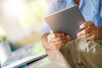 Closeup of digital tablet used by businessman