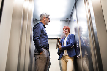 Business people in the elevator in modern office building.