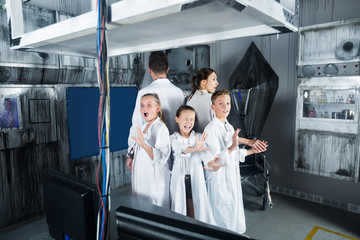 Family with kids depisting madness in room  stylized  laboratory
