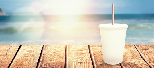Composite image of white cup over white background