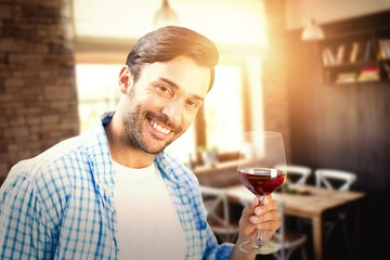 Composite image of smiling man with red wine