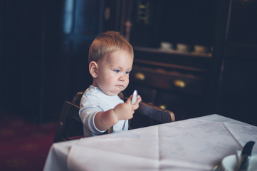 Baby in high chair at table