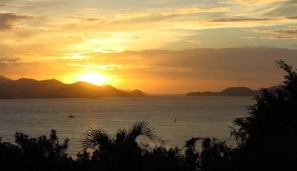 sunrise sunset over distant islands