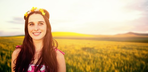 Composite image of beautiful woman with a flower crown
